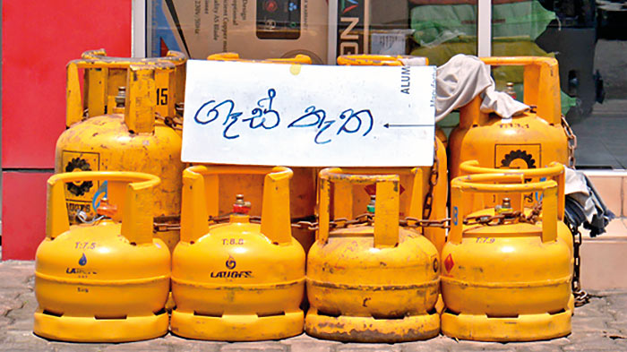 GAS - MILK IMPORTERS CRIPPLED BY DOLLAR SHORTAGE